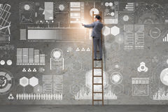 The man on the ladder in data management concept Stock Images