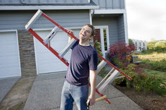 Man with Ladder and Hammer - Horizontal Stock Images