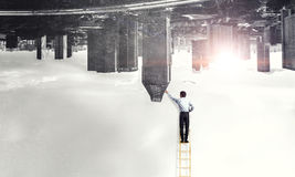 Man on ladder . Mixed media Royalty Free Stock Images