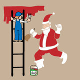 Man on ladder painting Santa Royalty Free Stock Images