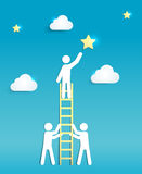 Man on a Ladder reaching for a Star. Support, Teamwork and Success Concep Stock Image