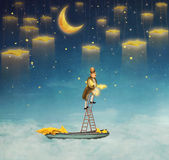 Man on a ladder reaching for  stars Stock Photos