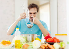 Man with ladle testing foul food Royalty Free Stock Photography