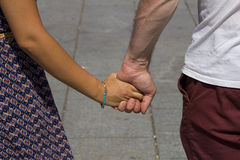 Man and lady holding hands Royalty Free Stock Photo