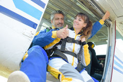 Man and lady poised to do tandem skydive royalty free stock photos