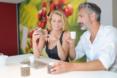Man and lady testing coffee. Coffee stock photography