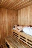 Man laid inside the sauna Royalty Free Stock Photos