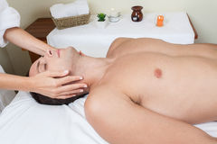Man laid receiving massage Royalty Free Stock Photography