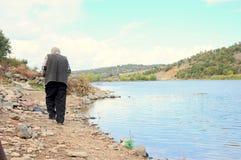 Man by lake Royalty Free Stock Image