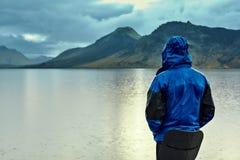 Man on the Lake coast with mountain reflection, Iceland Royalty Free Stock Photos