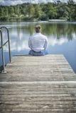 Man at the lake Royalty Free Stock Photos