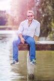 Man at the lake. An image of a bearded man at the lake Royalty Free Stock Image