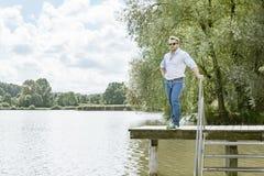 Man at the lake. An image of a bearded man at the lake Stock Photo