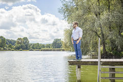 Man at the lake. An image of a bearded man at the lake Stock Images