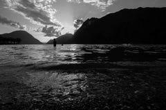 A man in a lake. A man in the lake of Lugano in Italy, at nightfall Royalty Free Stock Photography