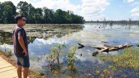 Man at Lake of Preah Neak Pean, Siem Reap, Cambodia Royalty Free Stock Photos