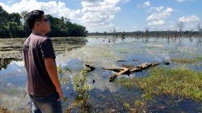 Man at Lake of Preah Neak Pean, Siem Reap, Cambodia Royalty Free Stock Image