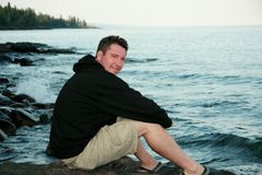 Man on Lake Superior Shore. Attractive man smiling on the shore of Lake Superior Royalty Free Stock Images
