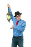 Man with lamp Stock Photo
