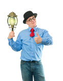 Man with lamp Royalty Free Stock Images