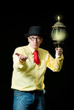 Man with lamp Royalty Free Stock Photography