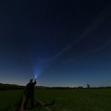 Man lantern illuminates the dark starry sky. Photographed by the Stock Photos