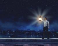 Man with lantern Stock Image