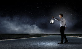Man with lantern Royalty Free Stock Images