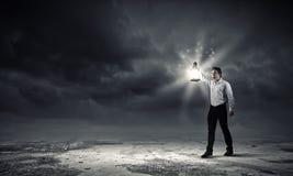 Man with lantern Royalty Free Stock Image