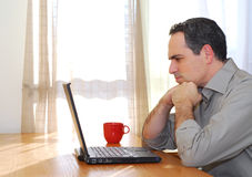Man with laptop Stock Images