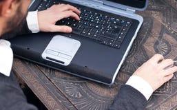 Man at laptop. Business man at laptop, typing Royalty Free Stock Photo