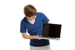 Man with a laptop. Handsome young man holding a laptop isolated over a white background Royalty Free Stock Image