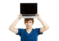 Man with a laptop. Handsome young man holding a laptop isolated over a white background Stock Photo