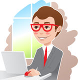 Man at the laptop. A man in a gray suit and glasses at work Royalty Free Stock Image