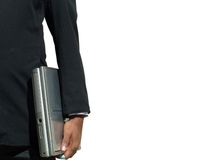 Man with a laptop. An indian man carrying a laptop with his left hand Royalty Free Stock Photos