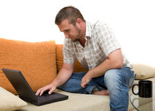 Man with laptop Stock Photography