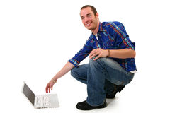 Man with Laptop. Attractive 20 something man with laptop on floor Royalty Free Stock Photos
