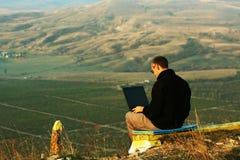Man with a laptop Royalty Free Stock Photos