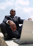 Man on laptop. Working outside Royalty Free Stock Photos