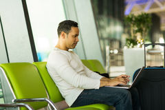 Man laptop airport Stock Images