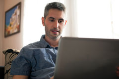 Man with the laptop Stock Images