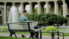 Man with laptop on a bench stock video