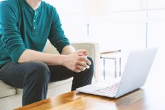 Man on a laptop in bright room Stock Photos