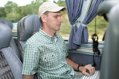 Man with laptop in the bus Royalty Free Stock Photo