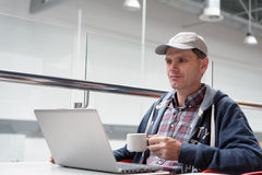 Man with laptop in cafe Royalty Free Stock Image
