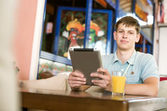 Man with a laptop in a cafe Stock Images