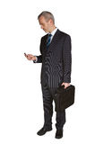 Man with laptop case and mobile phone Royalty Free Stock Photography
