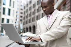 Man with Laptop in City stock image