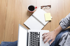 man with laptop computer, coffee cup and eyeglasses - top view Royalty Free Stock Photo