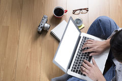 man with laptop computer, coffee cup and eyeglasses - top view Royalty Free Stock Images